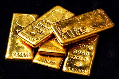 золотые слитки золото
